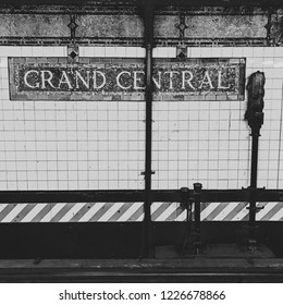 Detail of New York Metro Station with Grand Central Sign. Black and white design, square format, asymmetric image, retro look.