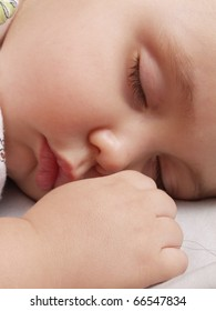 Detail of a newborn baby sleeping.
