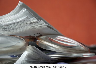 Detail of newspapers with glasses on the table