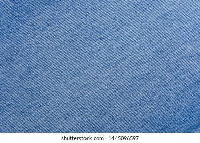 Detail of nice blue jeans. Jeans texture or denim background.