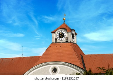 Detail of the Nymphenburg Palace of Munich (Schloss Nymphenburg - Castle of the Nymphs) with the clock and bell tower. Summer residence of the former rulers of Bavaria, Germany