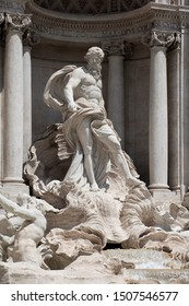 Detail of Oceanus on the famous Trevi Fountain, a major tourist attraction in Rome. The giant statue stands in front of a classical colonnade in the centre the fountain.