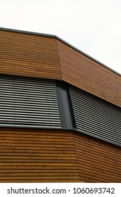 Detail of an office building  with blind and wooden facade