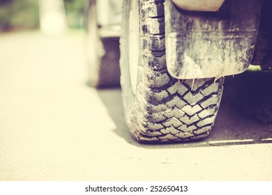 Detail of a Off-Road Tire Covered with Mudd
