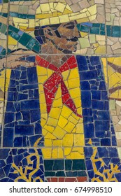 Detail of old antique mosaic with colored glass on wall of destroyed building built in 1947 in USSR. typical plot of street art of USSR period. Mass street culture of primitive Soviet poster. Mosaic