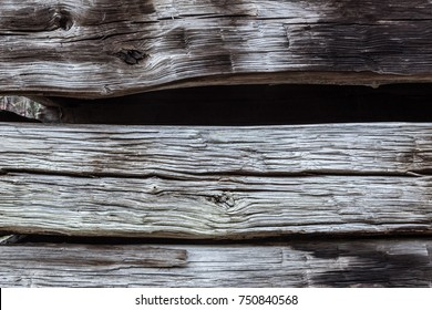 Detail of old barn exterior showing stacked hand hewn beams, horizontal aspect
