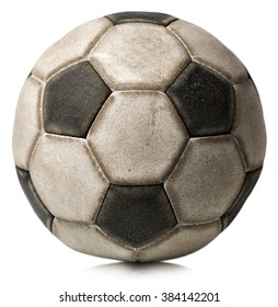 Detail of an old black and white soccer ball (Football) isolated on white background