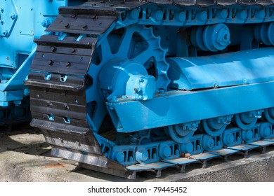 Detail of an old blue bulldozer