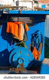 Detail of an old blue fishing boat docked in port - La Spezia, Liguria, Italy