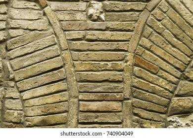 Detail of an old brick wall with parts two arches. Backgrounds and textures.