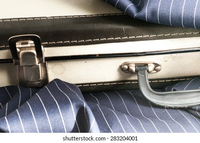 detail of an old cardboard suitcase next to a cloth
