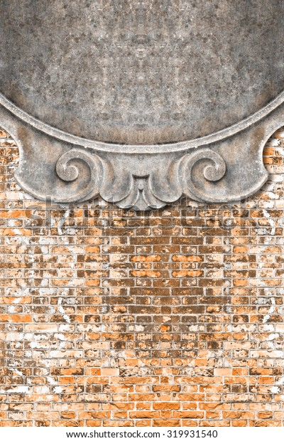 Detail of an old classic carved frame against a brick wall