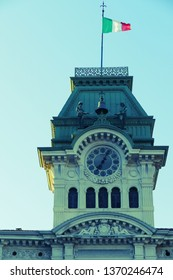 Detail of old clock and bell tower from Town Hall Building in Trieste, Italy. View from Square of Italian Unity. Vintage processing.