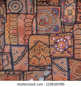 Detail old colorful patchwork carpet. Close up