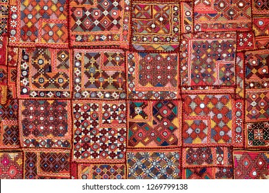 Detail old colorful patchwork carpet, India. Close up