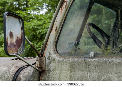 detail of an old decaying, abandonded truck