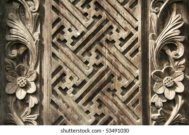 detail of old decorative wooden panel in bali indonesia