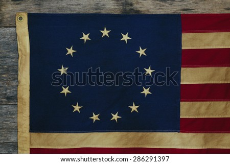 99adad2949e2 Detail of old dingy Betsy Ross Flag designed during the American  Revolutionary War features 13 stars