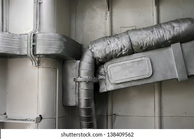 Detail of an old exhaust pipe with asbestos cover.(Ship engine room)