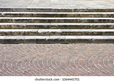 Detail of an old italian stone staircase whit paving stone in porphyry cube shape - image with copy space