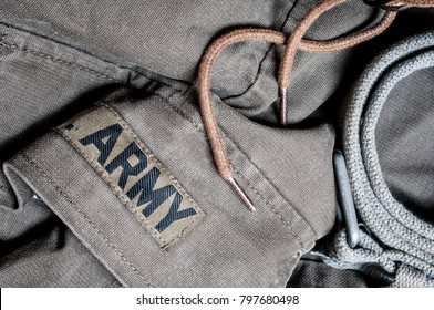 Detail of an old military jacket and belt for bckground or banner