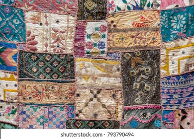 Detail of a old patchwork carpet . Close up