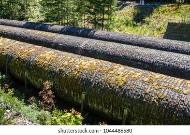 Detail of Old Pipelines in a Hydroelectric Power Plant on a Sunny Summer Day. Campbell River, BC, Canada.