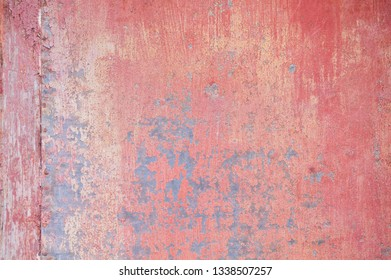 Detail of old red metallic wall background or texture