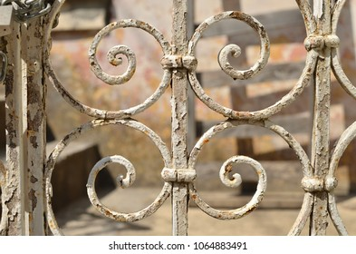 Detail of an old retro iron fence made with decorated ironwork elements