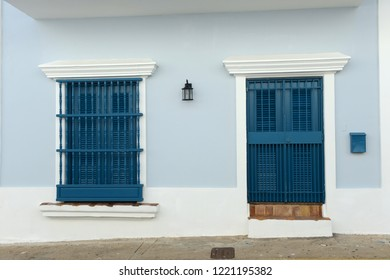 Detail of an old San Juan house in Puerto Rico with door and window in blue tones