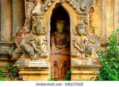 Detail of old stone temple ruins with statues, Myanmar (Burma)