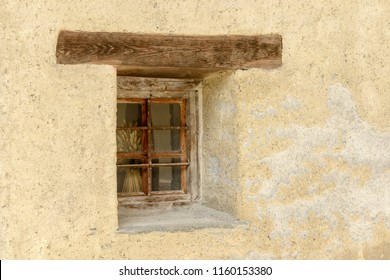 detail  of  old traditional house little window with wooden lintel, shot on a bright summer day at Gressoney Saint Jean,  Lys valley, Aosta, Italy