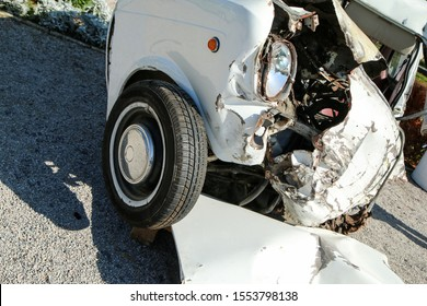 The detail of an old veteran small car after the collision with a modern car during the traffic accident. The car is destroyed completely. Shows the low level of passive safety.
