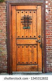 Detail of a old wooden door on a brick building
