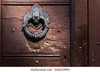 Detail of old wooden door in Rome