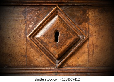 Detail of an old wooden lock with a keyhole