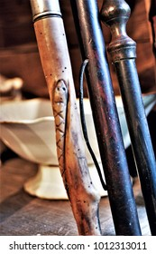 detail of old wooden walking sticks,  in the kitchen of a rural house in Galicia, old wooden furniture, old food storage containers, typical rural cuisine of Galicia, Galician ethnographic museum,