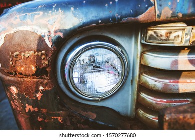 Detail of oldtimer vintage car. Front light of retro classic automobile.