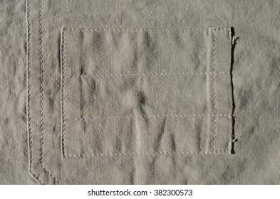 Detail of olive-gray shirt pocket