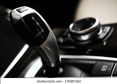 Detail on a automatic gear shifter in a new car