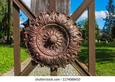 Detail on the gate near church in the village of Pomorska Wies near Elblag, Masuria, Poland