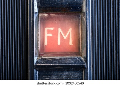 Detail on Grungy and old radio , FM radio sign
