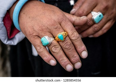 Detail on hands of elderly ethnic Indian woman with large rings on her fingers.