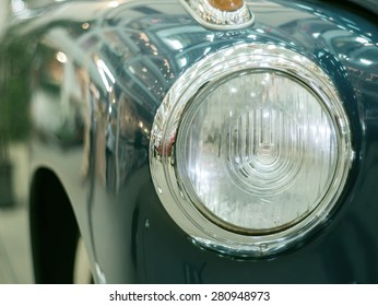 Detail on the headlight  lamp of a vintage retro classic car(Vintage effect style picture)
