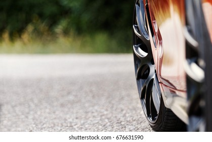 Detail on hot red sport car wheels with sport breaks