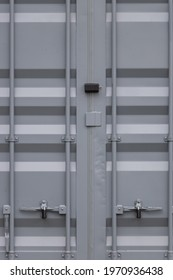 detail on the locked door of a gray shipping container