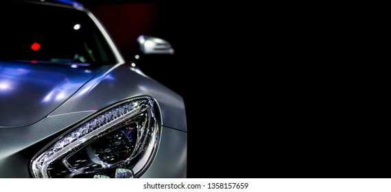 Detail on one of the LED headlights super car for copy space