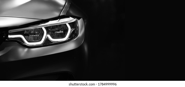 Detail on one of the LED headlights modern car on black background,copy space