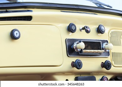 detail on the radio of a vintage car