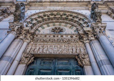 Detail on romanesque Facade of St. Martin Cathedral at Piazza Antelminelli in Lucca, Tuscany. It contains most precious relic in Lucca, Holy Face of Lucca - Italian: Volto Santo di Lucca
